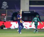 :Dubai:Indian cricket captain Virat Kohli celebrates after scoring half a century during the Cricket Twenty20 World Cup match between India and Pakistan,