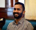 Dinesh Karthik talks to the press