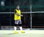 MS Dhoni during a football match
