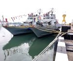 Decorated Indian Navy warships at Kochi Harbour on Navy Day
