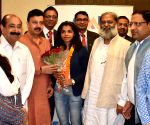 Sakshi Mallik arrives in India