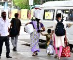 Interstate (migrant) workers gathered at Bengaluru City Railway station to travel to their native places due to surge in covid-19 during Coronavirus pandemic, in Bengaluru