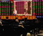 Chinese shares open higher; yuan weakens