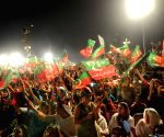 Pakistani opposition politician Imran Khan arrives at an anti-government protest
