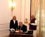 Benjamin Netanyahu signs the visitors' book of Hyderabad House