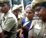 Nalini, one of the convicts in the former Prime Minister Rajiv Gandhi assassination case, being taken to a court from a central prison in Vellore