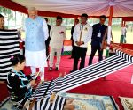PM interacts with loin loom weavers of Arunachal