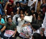 IYC protest at Smriti Irani house over alleged bribery in K'taka free egg scheme