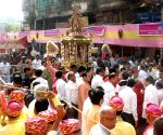 Jains participate in a religious procession