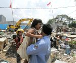 House being demolished at Pluit Reservoirs area in Jakarta