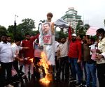 Jan Adhikar Party activists burn an effigy Union Petroleum Minister Dahrmemdra Pardhan protest against frequent hikes in the prices of petrol and diesel, and demand roll back of prices, in Patna, Wednesday, June 16, 2021