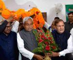 Sharad Yadav and Nitish Kumar during a party programme