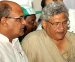KC Tyagi, Deve Gowda, Yechury demonstrate against land acquisition law