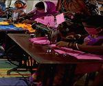 Free Photo: Bihar: Jeevika is making 'mask' to escape corona