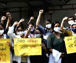 :Patna:Junior doctors from Patna Medical College and Hospital raise slogans during a protest to demand for increment of their stipend,