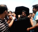 People attend the funeral of a target killing victim in southern Pakistani port city of Karachi