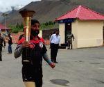 Drass (J&K): Kargil hero runs last lap with Victory Flame in Drass on Vijay Diwas