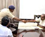 IPS officer K. Annamalai meets H D Kumaraswamy