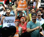 'We're coming back home': Kashmiri Pandits roar at Jantar Mantar