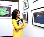 Actors, filmmakers, poet during photography exhibition