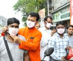 Bengal BJP workers distribute Modi-named masks to fight corona