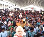 Modi masks, T-shirts big hit in Kolkata rally