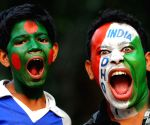 Cricket fans painted in the colours of India and Bangladesh