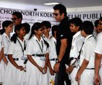Formar Pakistani cricketer Wasim Akram at a school