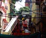 Damaged buildings being repaired at Bowbazar