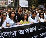 Intellectuals participate in a rally against the alleged use of CBI for political motives