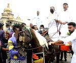KPCC President DK Shivakumar and Congress MLAs along with CLP leader and former CM Siddaramaiah ride a MLC horse to reach Vidhana Soudha for the assembly session during a protest against hike in fuel and LPG prices by the central BJP government, in Bengaluru