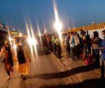 Free Photo: Laborers from Bihar at Sarai Kale Khan waiting for bus to go phagwara Punjab to work in Mandi