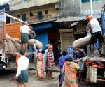 Labourers at work amid protests during nationwide trade union strike