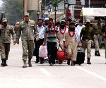 Released Pakistani prisoners walk across the Wagah border in eastern Pakistan's Lahore