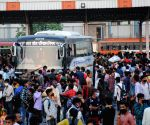 Large numbers of migrants at Kaushambi bus stand to board buses for their native place , after lockdown announcement