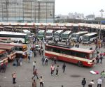 : Large numbers of migrants at Kaushambi bus stand to board buses for their native place , after lockdown announcement in National Capital in the wake of rising Covid-19 cases, in New Delhi, Tuesday, April 20, 2021