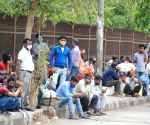 Large numbers of migrants at Red Fort bus stand to Bihar and UP, after lockdown announcement in National Capital in the wake of rising Covid-19 cases, in New Delhi