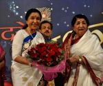 File Photo: Lata Mangeshkar and Asha Bhosle