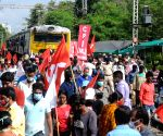Kolkata : Left Front Liberation activists along with CPI(ML) block railway tracks in support of 'Bharat Bandh' called by farmers unions to protest against three central government's agricultural laws in Kolkata
