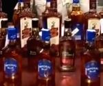 Free Photo: Bihar: Liquor recovered from a police vehicle carrying 'logos', 2 arrested
