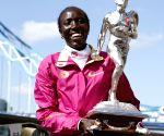 The champions photocall of 2014 London Marathon in London