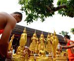 LAOS LUANGPRABANG BUDDHA STATUES WASHING
