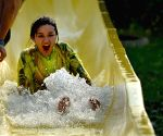People have fun at a water park in Luoyang, central China's Hunan Province