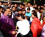 Pappu yadav meets students agitating over nursing student's suicide