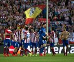 Atletico Madrid's players celebrate after winning their UEFA Champions League quarter-final match against Barcelona