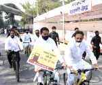 Free Photo: Mumbai:Maha Cong ministers protest high fuel prices on bicycles