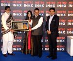Devendra Fadnavis, Amruta Fadnavis and Amitabh Bachchan at the inauguration of a cinema theatre