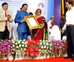 Maharashtra Governor felicitates SIES College Principal