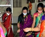 Mahashtrian womens offering prayer to Banyan Tree at Prabhadevi during traditional Vat Purnima Celebration in Mumbai.