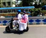 Free Photo: Mamata Banerjee rides e-scooter to protest petrol price hike